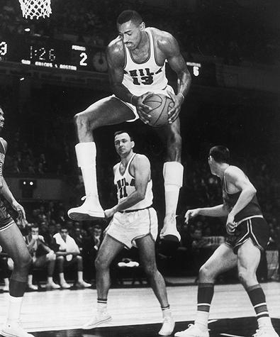 Wilt goes up for a rebound