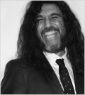 Tom Araya, the front man and bassist from Slayer, looking suave in a suit...