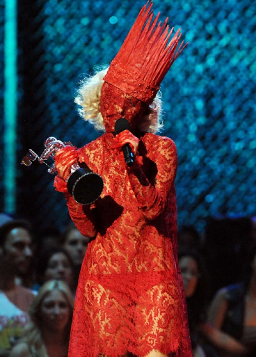 Lady Gaga wearing Alexander McQueen's red lace dress