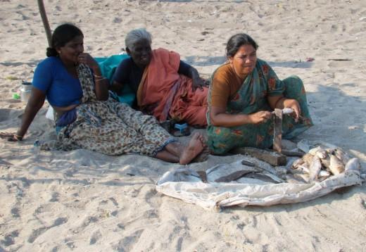 Fisher women at Dhanushkodi scaling fishes