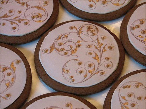 Sumptuously decorated Gingerbread Biscuits reminiscent of ancient gilded script.