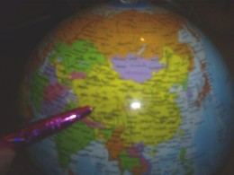 Pointing to China on my globe.