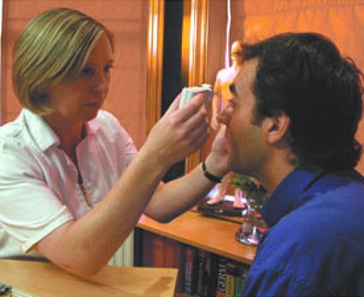 A naturopath examining a patient