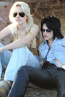 "Twilight stars Kristen Stewart and Dakota Fanning in the film ""The Runaways""."