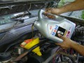 Fill Engine with New Oil (autorepair.about)