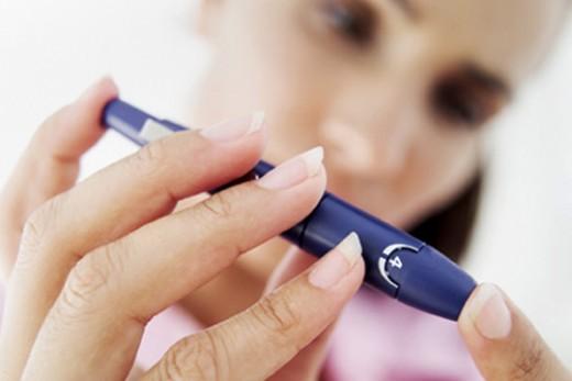 Testing blood glucose levels - photo credit: myhealthguardian.com