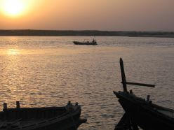 Boats - grounded as well as sailing - on the Ganges as the sun is about to set.