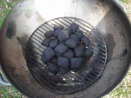 ARRANGE THE CHARCOAL IN THE CENTER OF THE GRILL