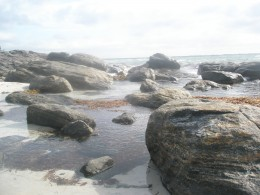 You hear the rut of the shore, the waves breaking on stone and  then a pair of smooth shaped rocks.