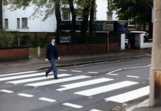 paul stopping the traffic as he strides over the famous Abbey road crossing! In the background you can see the Royal philharmonic orchestra's lorry. They were busy recording the first of their 'Hooked on classics' albums