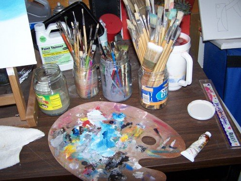 My paints, wooden palette and paint brushes, along with mineral spirits, all handy to use by my easel.