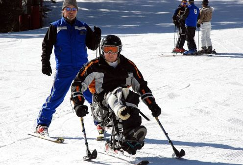 Sgt. Anthony Larson with his adaptive ski instructor at Vail, Colorado in 2007. Sgt. Larson lost his right leg below the knee while serving in Iraq.