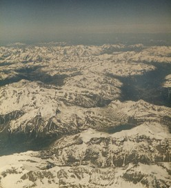 The Alps from above. Craggy and White. Copyright Tricia Mason 1980