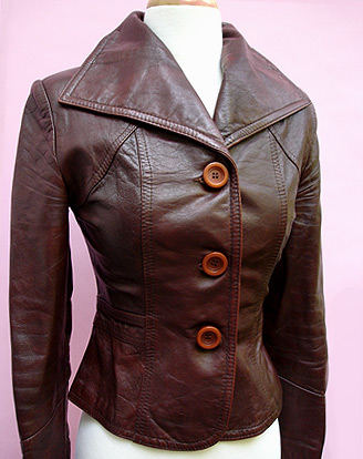 Posh Vintage best of Vintage Leather Jacket.  Soft but rugged.  Oversized Cognac Buttons.