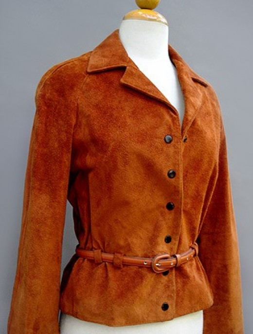 Vintage brushed sued jacket in burnt orange colour with leather belt. 1970s from Neiman Marcus by Anne Klein.