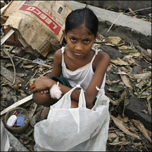A YOUNG GIRL AFTER THE TROPICAL CYCLONE THAT DEVASTATED MYANMAR in 2007