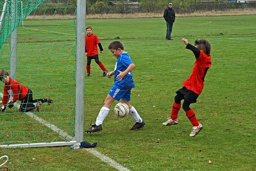 Children playinf Soccer    Source:Flickr