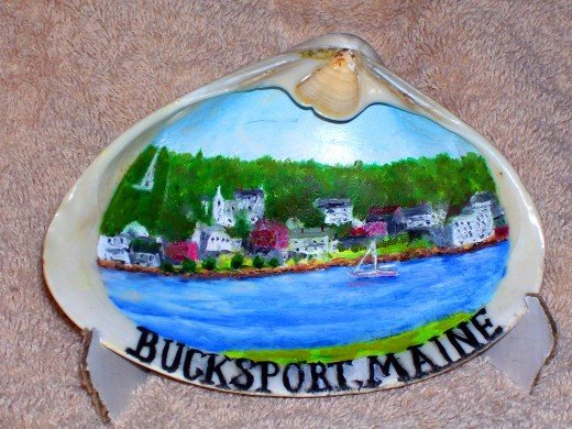 A large clam shell from the coast of Maine hand painted from a photo of the town of Bucksport Maine.