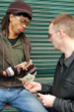 Drug money being exchanged. This is done openly in public.