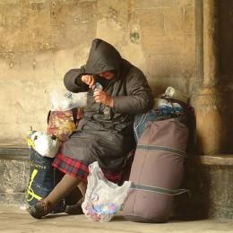 Dinnertime for a homeless woman