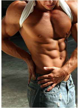 Six pack abs on male in blue jeans