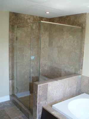 Frameless shower doors make the bathroom appear larger.