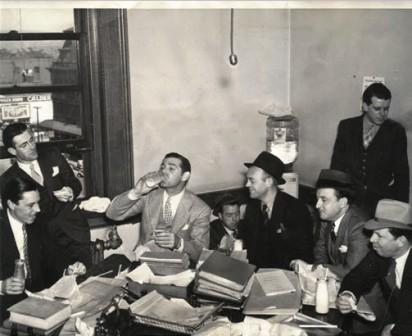Clark Gable, third left, with reporters during a refreshment break in the trial.