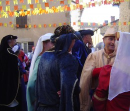 Local people perform dances in the streets in full mediaeval costume