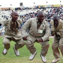 Bishop Lekganyane's male dance troupe in the act and wearing their Khaki uniforms and white made-of-tire boots