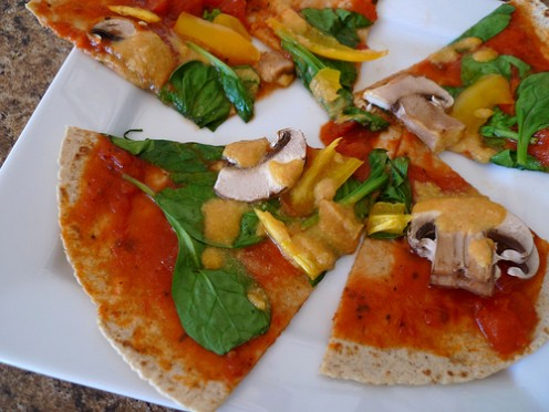 """Homemade pizza with nutritional yeast """"cheese"""" sauce."""