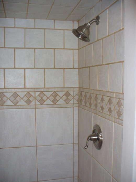 Inlaid tile shower enclosure from jackmasterson.com