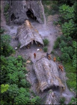 Tribe members in their huts