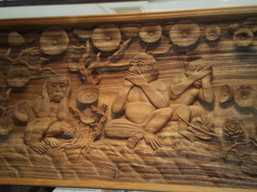 Intricate wood carving of monkeys on sale at factory near Bangkok.