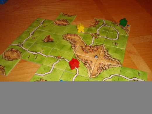 "Sample Carcassonne game with ""Meeples"""