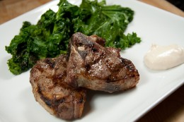 "A good example of a ""real food"" dinner - lamb chops, kale and yogurt sauce."