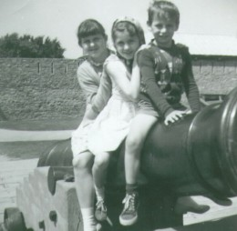 My older sisters, Jane Ann & Janice with me sitting on a cannon at Old Fort Erie.