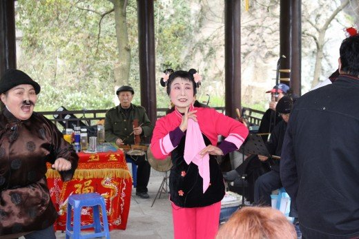 People from Western China perform traditional opera.