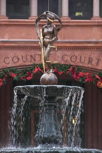 Image Credit:  http://www.texasescapes.com/SanAntonioTx/Images/BexarCountyCourthouseLadyJustice120808TJnsn2.jpg