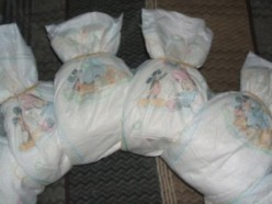 Secure each diaper around the wreath base by using clear rubber bands.  (These are not clear but the only ones I had)