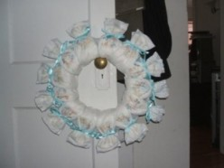 Embellish the wreath base with colorful and/or curly ribbon to hide the rubber bands.