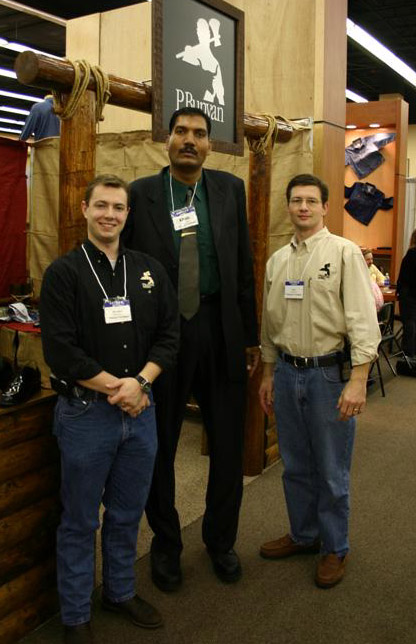 """At a show in Miami, my partner and I posed with Kahn, a 2BigFeet customer, who was previously the tallest man alive. (That's me on the right, and I'm 6'4"""".)"""