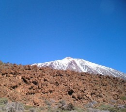Snow-capped Mt Teide and volcanic rocks