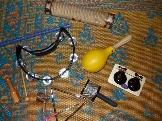 Pictured are tambourine, guiro, cabasa (also called afuche), maraca, concert castanets, triangle.