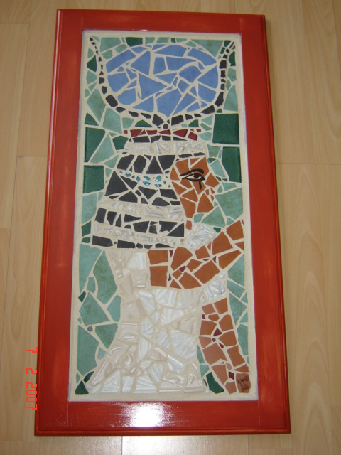 Egyptian Goddess, ceramic and bits of stained glass grouted in hardwood frame
