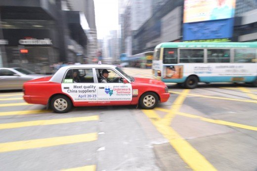 Panning shot of a red cab in Central of Hong Kong