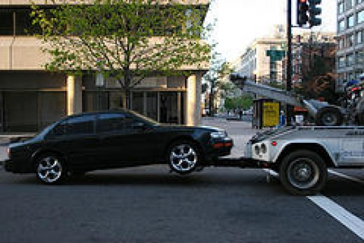 Car with Dead Battery Getting Towed (Photo from Flickr)