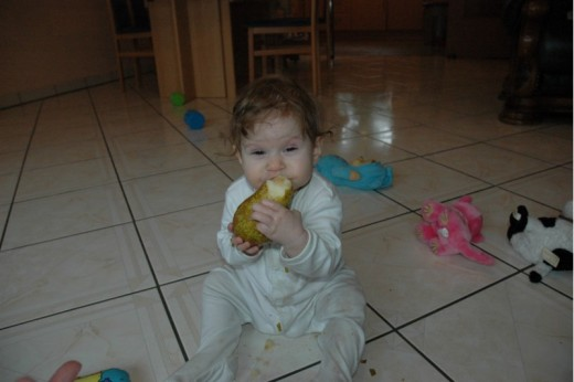 Maya's first taste of pear!