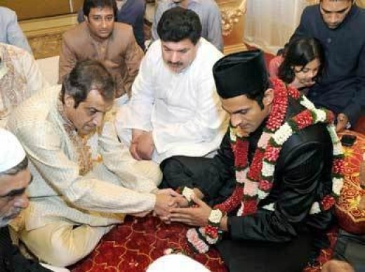 Shoaib-during the nikha ceremoney.Sania's father  giving him something.