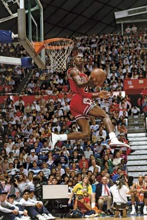 Michael Jordan showcasing his amazing vertical jump in the NBA slam dunk contest