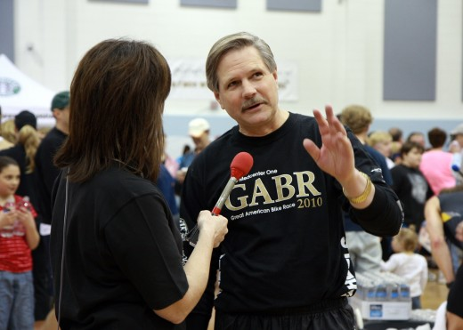 North Dakota governor, John Hoeven gets interviewed by a local television station at the race